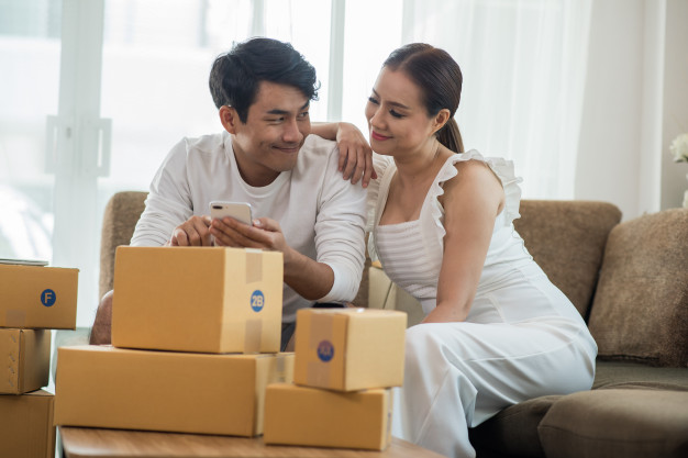 happy-couple-at-home-office-with-online-business-marketing-online-and-freelance-job_1150-4977